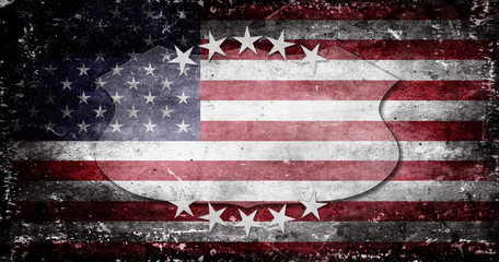 The US flag destroyed from military operations with a shield and white stars