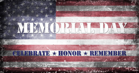 US flag with traces of use in battle and destruction from difficult military operations with the message Memorial Day - Celebrate, Honor, Remember