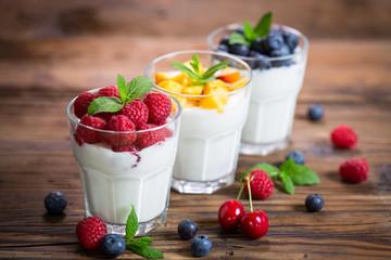 Fresh fruit yogurt with fresh berries and peaches