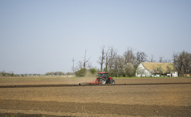Seeding crops at field - Tractor working on the field