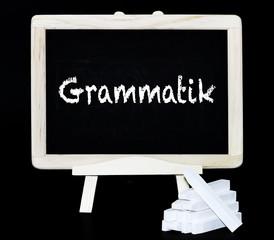Grammatik Kreideschrift auf einer Tafel