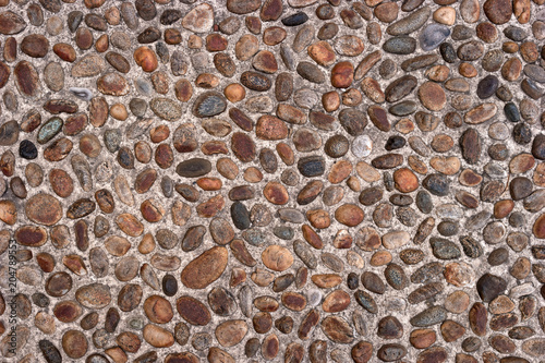 . Road from cobblestone to stone texture or seamless background