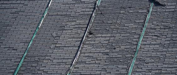 close up on damaged old shingle roof background