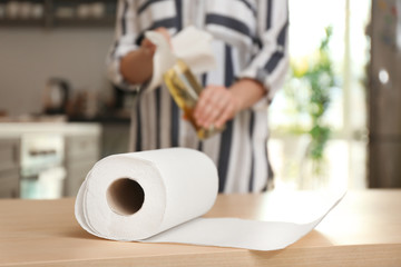 Roll of paper towels and blurred woman on background
