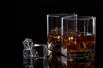 Whiskey glasses with ice.