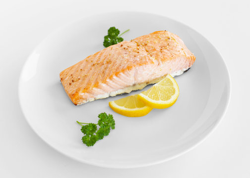 Cooked salmon with lemon and parsley
