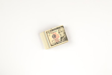 Stack of USA 10 dollars isolated on white background.