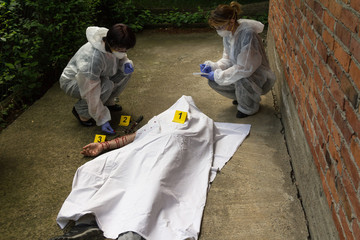 A forensic team at the crime scene. Collecting evidence