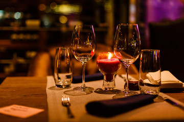 Two wine glasses and defocused lights at the restaurant