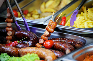 Grilled sausage close-up .