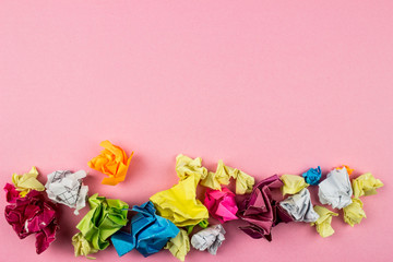Crumpled Color paper balls. Empty space for text and design. Rose background