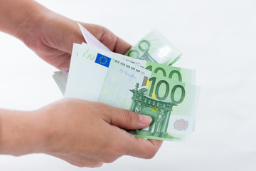 Euro banknotes of hands