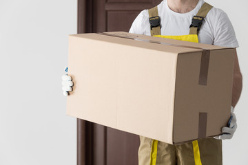 Delivery man with big box close-up