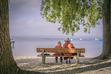 Beautiful family on the bench at the beach