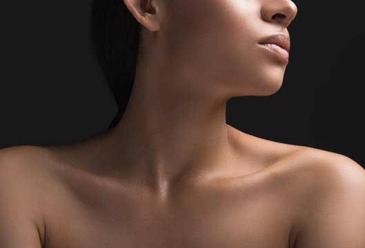 Close up of woman ideal naked pelt. Isolated on black background