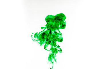 Green ink in water isolated on white