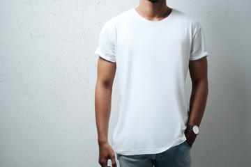 Guy wearing white blank t-shirt, grunge wall, horizontal studio close-up Wall mural