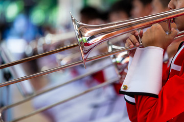 Play Musical instruments  in Marching band