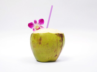 Coconut drink with straw and orchid