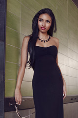 Beautiful young woman with dark exotic looks and long curly hair