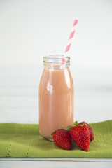 Strawberry Fruit Smoothy on a White Wood Table