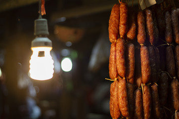 Meat sausage on night market. Fresh homemade sausage. Cambodian national food. Khmer cuisine.