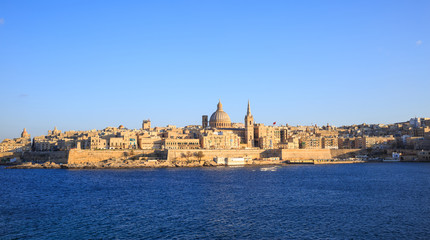 Valletta, Malta. Panoramic view of the historic island and the dome of Carmelite Church and St Paul`s tower.