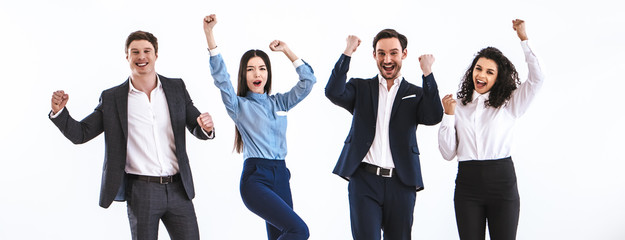 The four business people gesturing on the white background