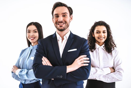 The three business people standing on the white background