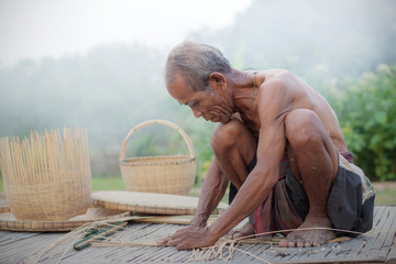 Old man with bamboo basketry.