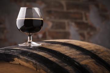 Obraz Glass of barrel aged stout - fototapety do salonu