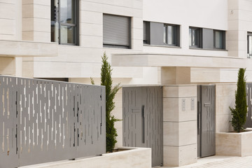 Modern residential building entrance. Estate property. Marble stone. Construction