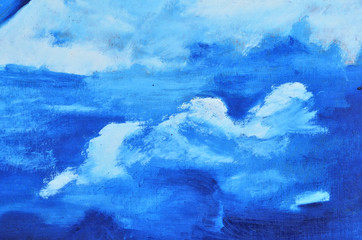 White clouds on canvas painted in blue