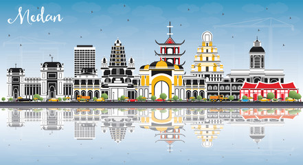Medan Indonesia City Skyline with Color Buildings, Blue Sky and Reflections.