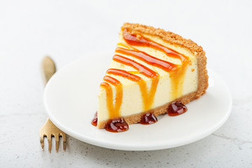 Slice of cheesecake with caramel sauce.