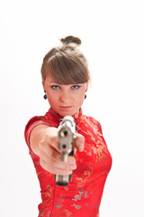 girl in red chinese dress with gun in hands