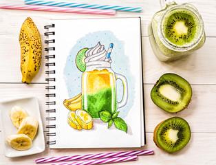a hand-drawn illustration wth milkshake in mason jar ina sketchbook decorated with a milkshake cocktail, kiwis,bananas and drinking straws on white wood background