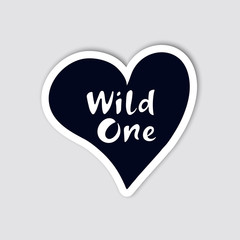 Silhouette of heart with hand drawn lettering inside. Creative sticker for travelling design. Wild one. Vector illustration.