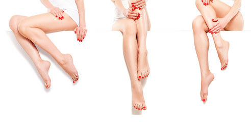 Beautiful slim womans with red manicure, sitting at banner, isolated on white background