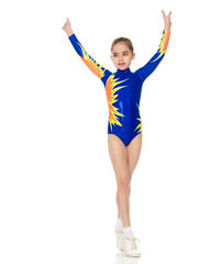 Beautiful girl gymnast performs exercises.