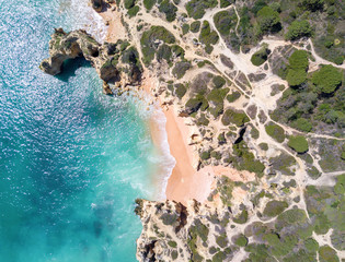 Fototapete - Aerial view of tropical sandy beach, cliffs and ocean.