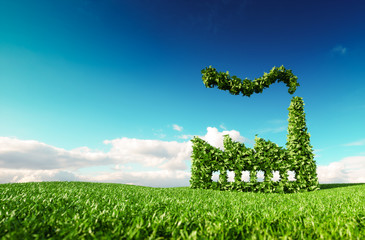 Eco friendly industry concept. 3d rendering of green factory icon on fresh spring meadow with blue sky in background.