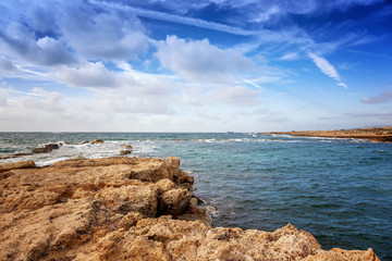 Fototapete - a fantastic stunning colorful landscape, a blue sea shore, the coast of Cyprus, the neighborhood of Paphos