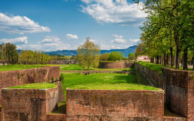 View of Lucca ancient city walls, ramparts and moat, completed in the 17th century and now a public park