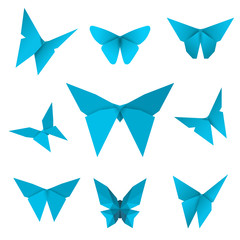 Set of flying isolated paper butterflies. Blue butterfly on the white background. Japanese origami, craft and paper style. Single elements for any decor. Vector Illustration.