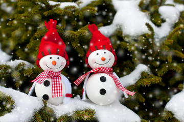 Winter, Christmas holiday background - Happy snowman friends in drifts