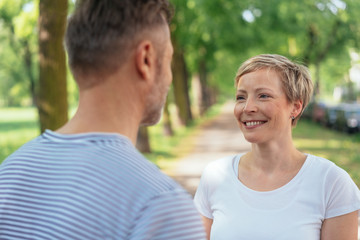 Smiling mature woman looking at man in park