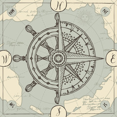 Hand-drawn vector banner with a wind rose, old nautical compass and steering wheel in retro style. Illustration on the theme of travel, adventure and discovery on the background of old map