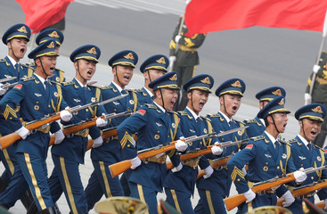 Honour guards march during a welcoming ceremony for Tobago Prime Minister Keith Rowley in Beijing