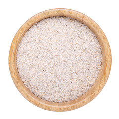 Whole psyllium husks in wooden bowl isolated on white.